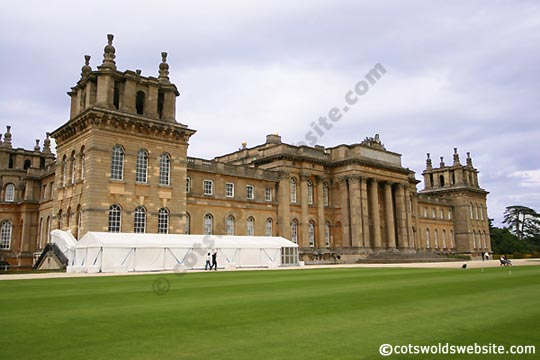 A view of Blenheim Palace. We think that the white marquee  is used to keep guests dry when raining. Possibly during the transfer of guests from one part to another. Image copyright CotswoldsWebsite.com
